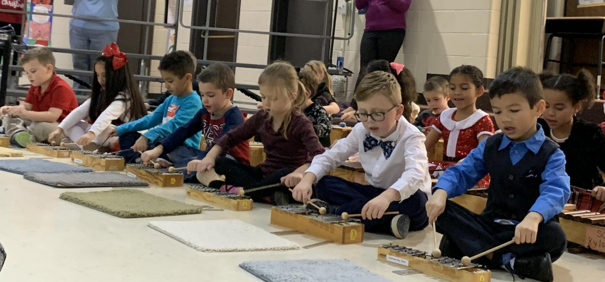 Students playing Orff Instruments